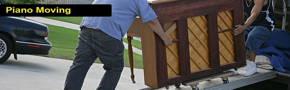 Piano Moving - movers unloading piano